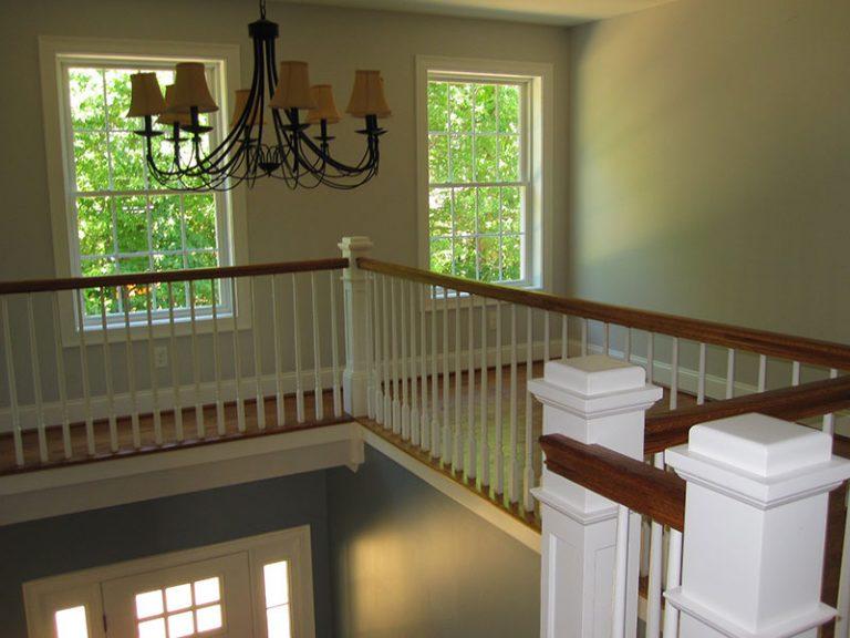Banister of upper level overlooking lower level