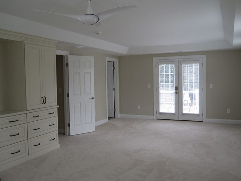 Bedroom with built-ins with doors to deck