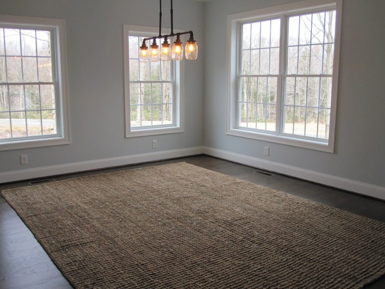 Dining room with chandelier and dark carpet