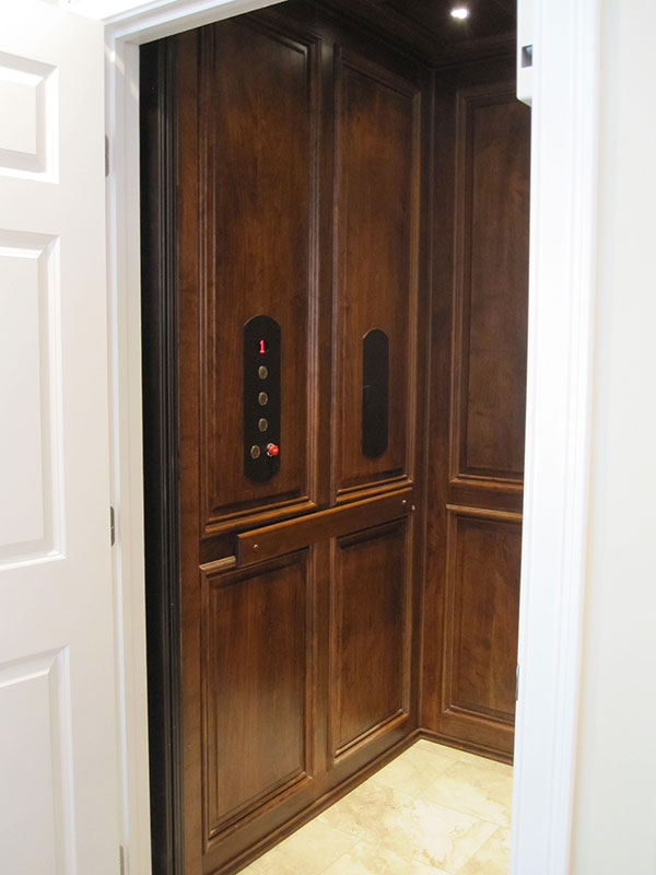Custom home with elevator done in dark hardwood