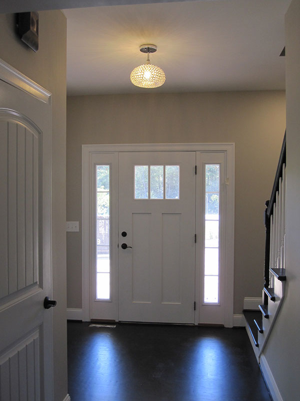 Entryway with staircase and hardwood floor