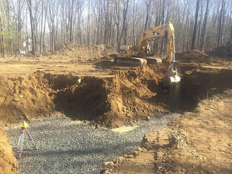 Excavating foundation hole