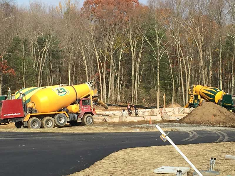 Several yellow cement trucks for foundation pouring