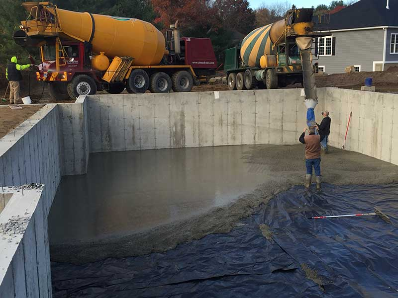 Pouring concrete for basement floor of foundation