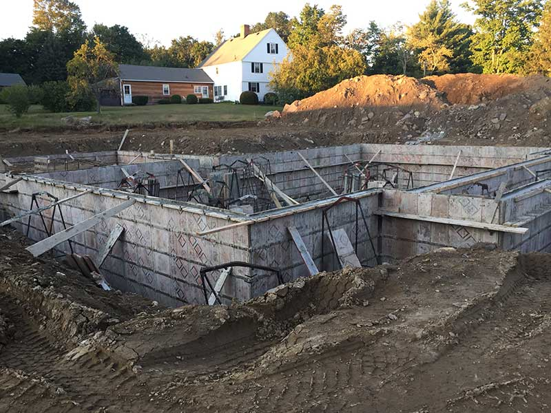 Custom home foundation with supports after pouring concrete