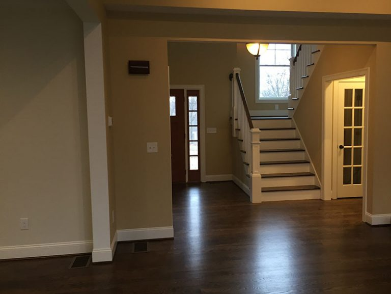 View to entryway with dark hardwood floor stairs