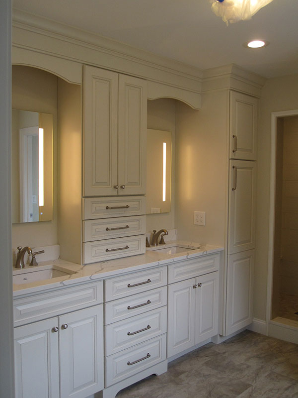 Bathroom with double vanity, drawers and shower