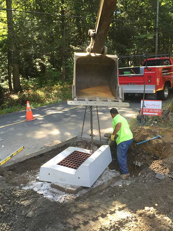 Installing cover of catch basin at side of road