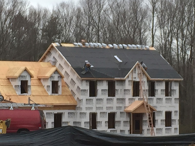 Installing roofing materials